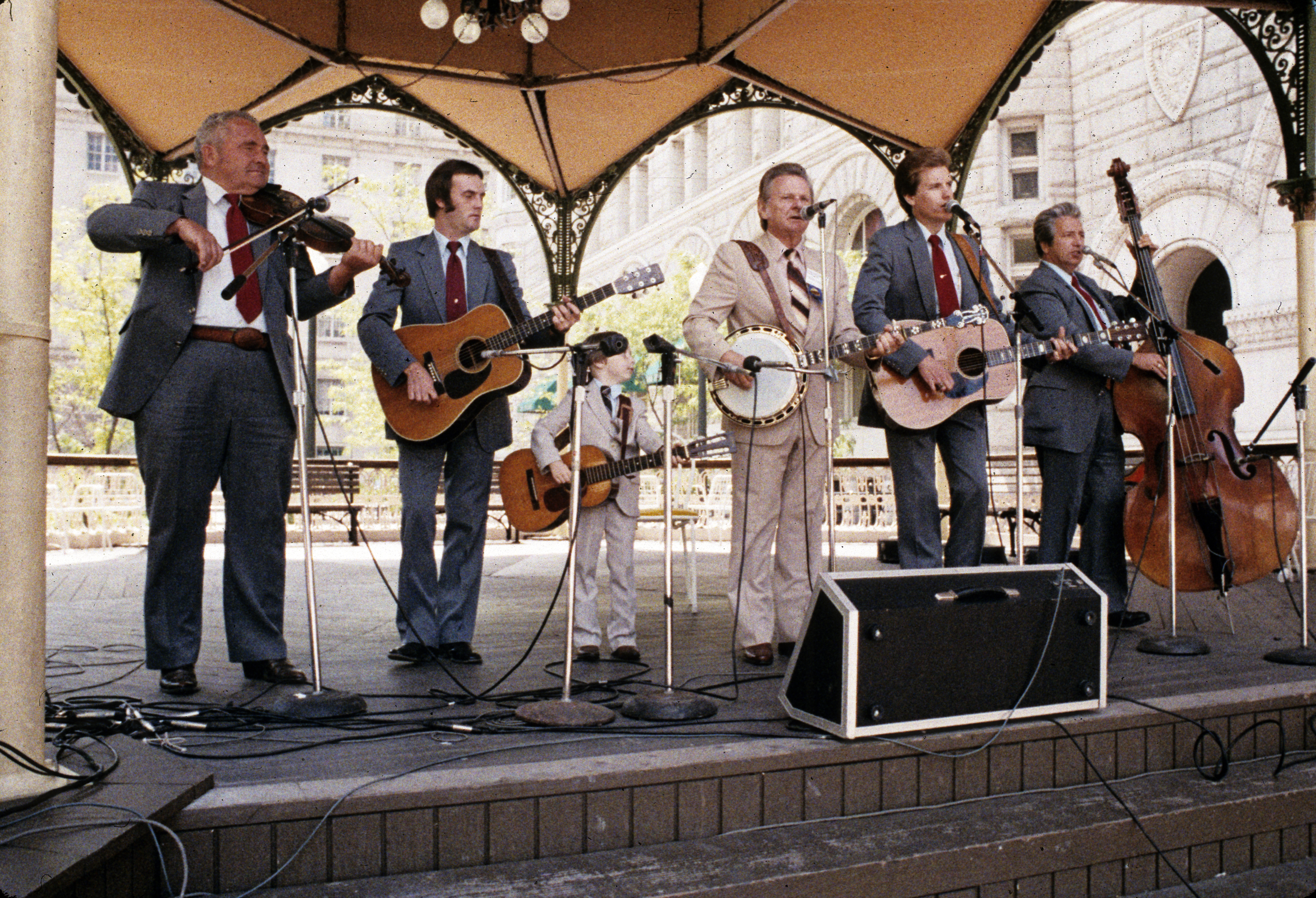 bluegrass band under tent performing in front of the Old Post Office building