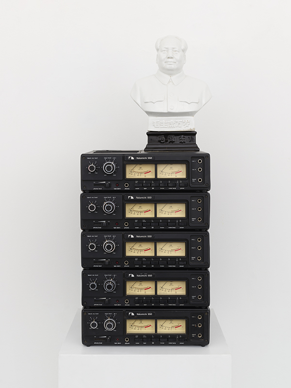 Bust of Chairman Mao on top of five cassette recorders.