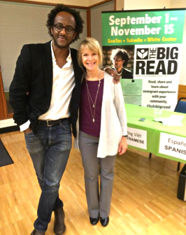 Author Dinaw Mengestu posing with a Big Read programmer