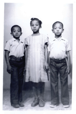 Old black and white photograph of three young children