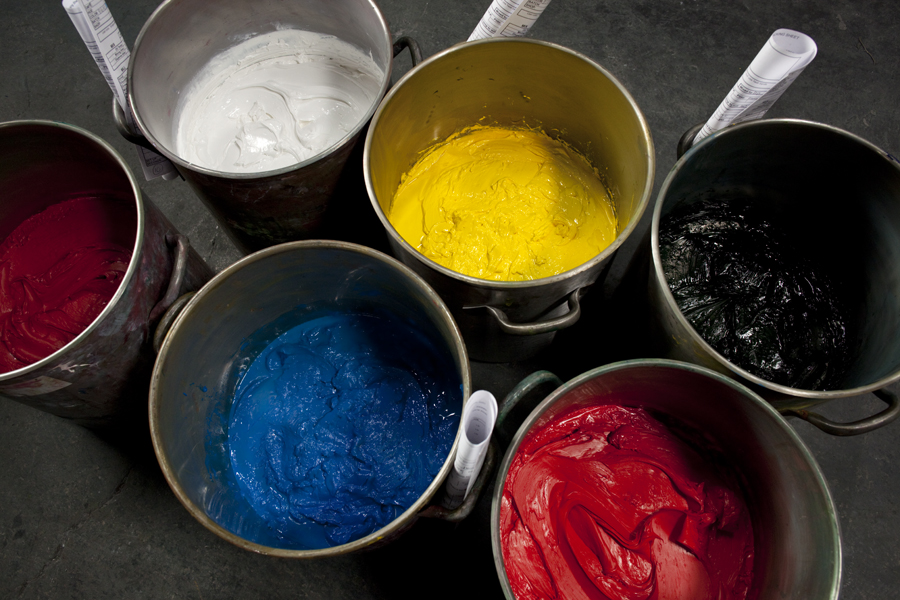 Buckets of red, white, blue, yellow, and black paint.