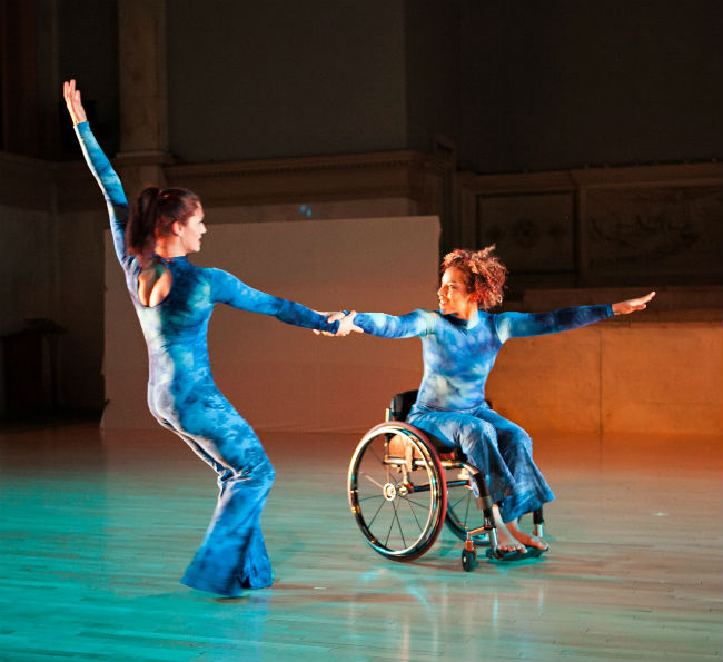 Two disabled dancers dancing with wheelchairs