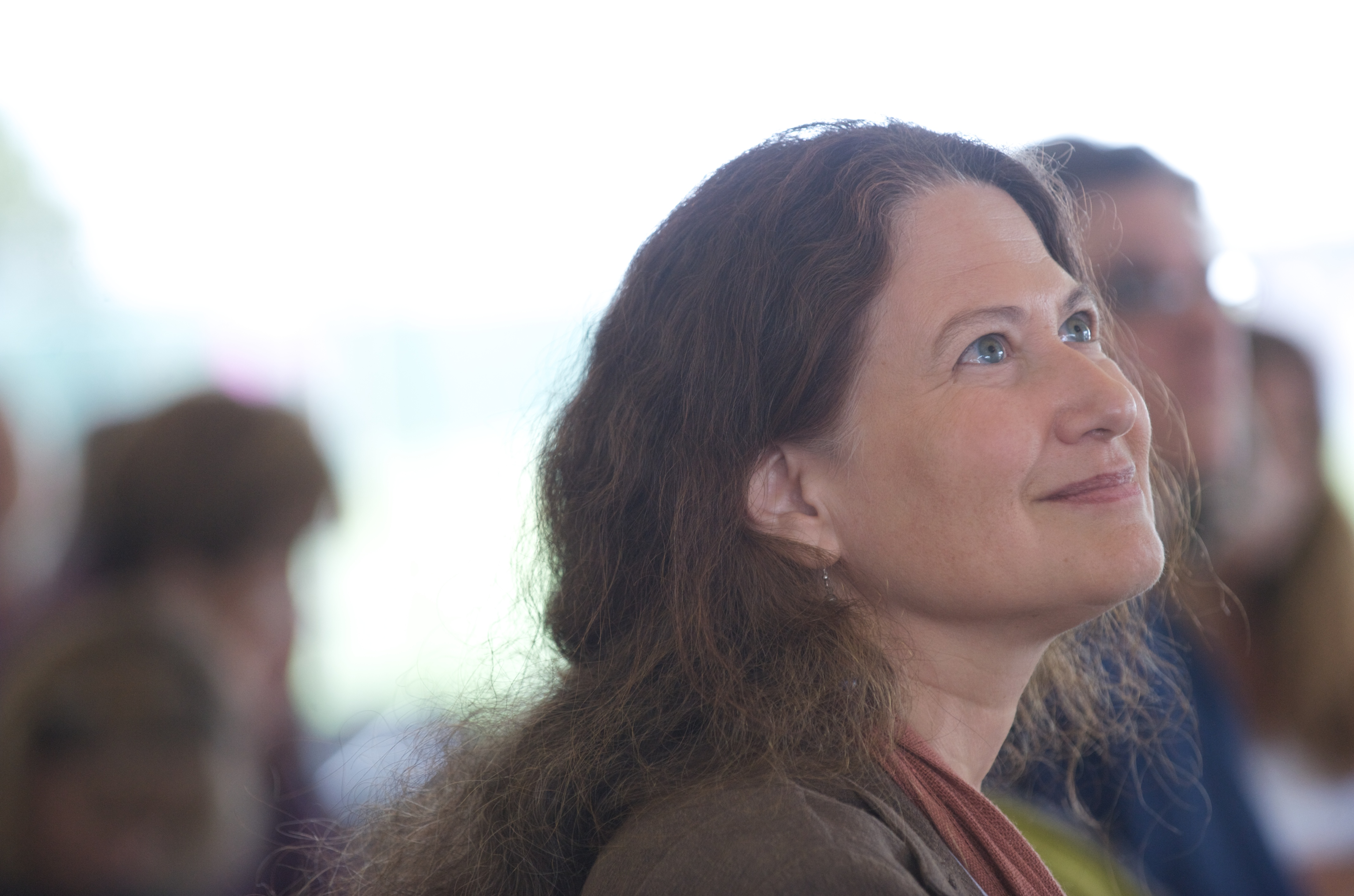 Jane Hirshfield looking up at a fellow reader.