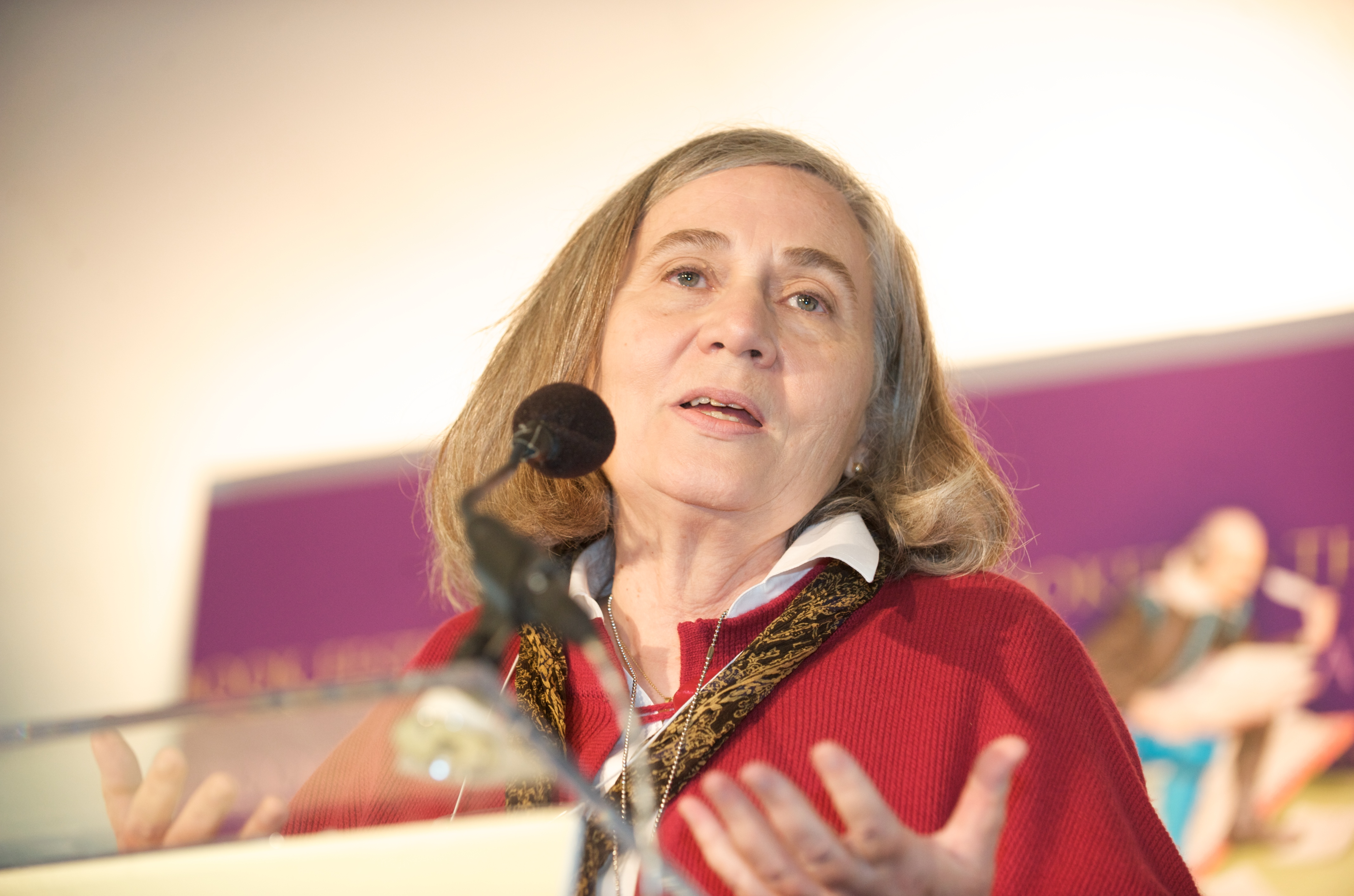 Marilynne Robinson speaking into a mic on stage.