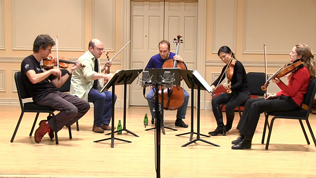 a string quintet practicing.