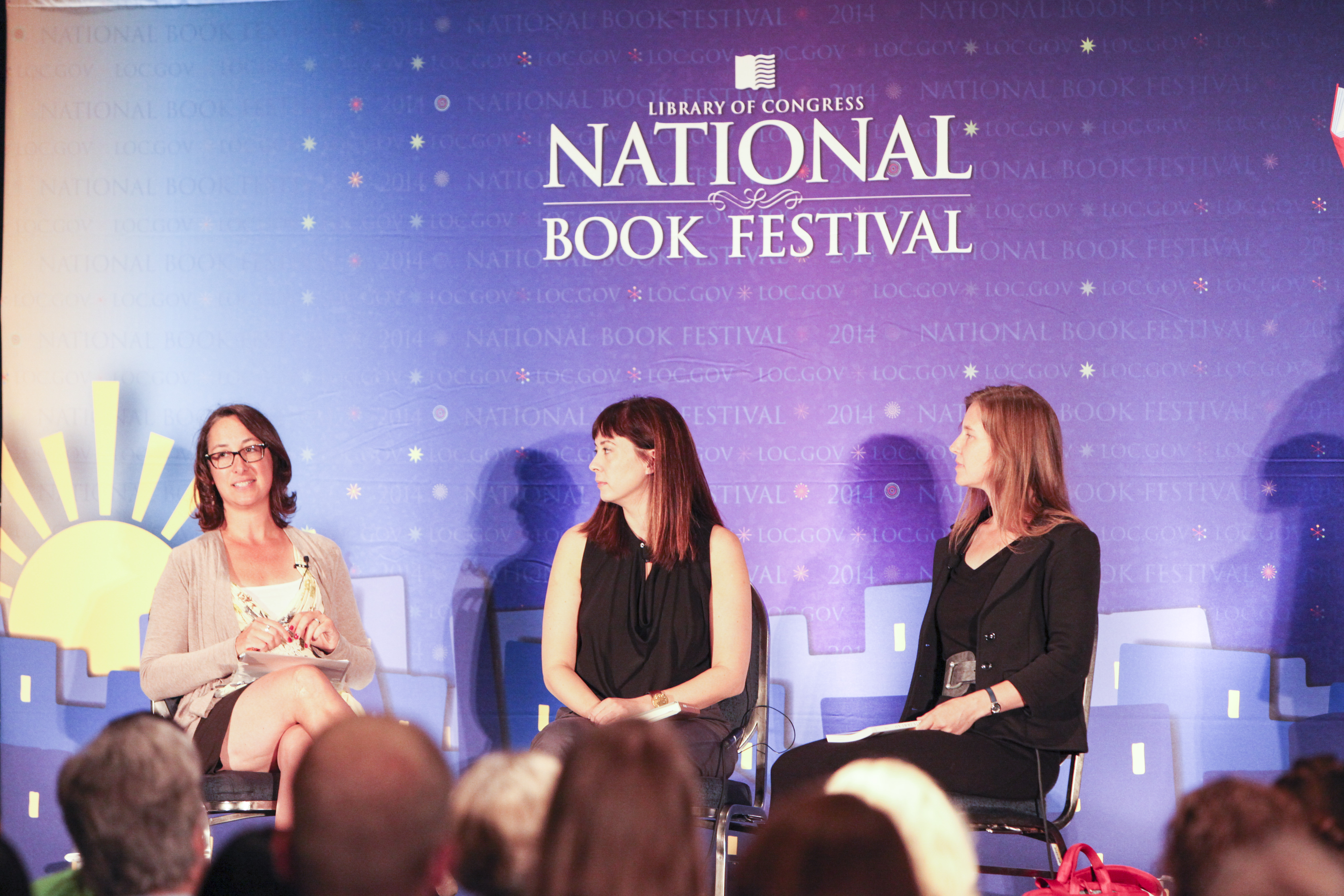 NEA Literature Director on stage with NEA Creative Writing Fellows Paisley Redkal and Eula Biss.