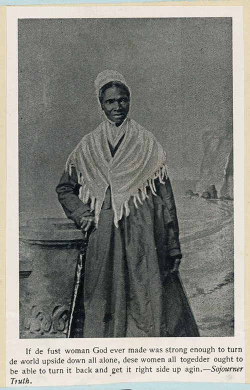 Black and white photo of African-American woman wearing white hat and shawl.
