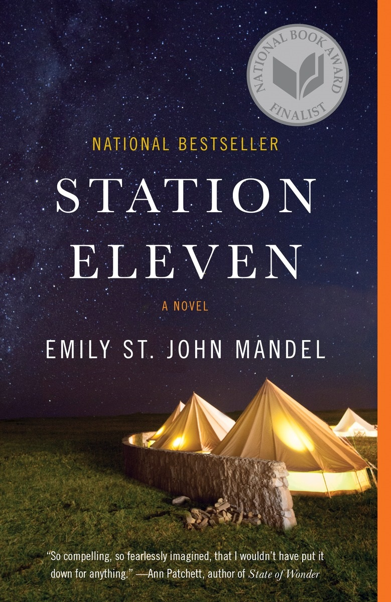 Book cover: title and author name in white over a background of large night sky and canvas tents illuminated from within behind a stone wall