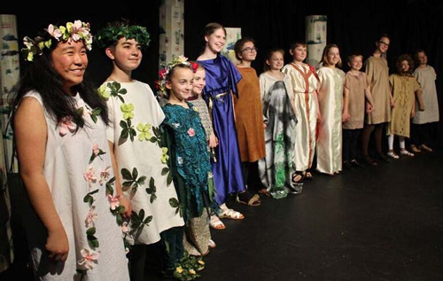 Young performers line up for standing ovation