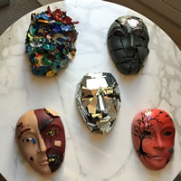 Masks made with different materials and colors on display.