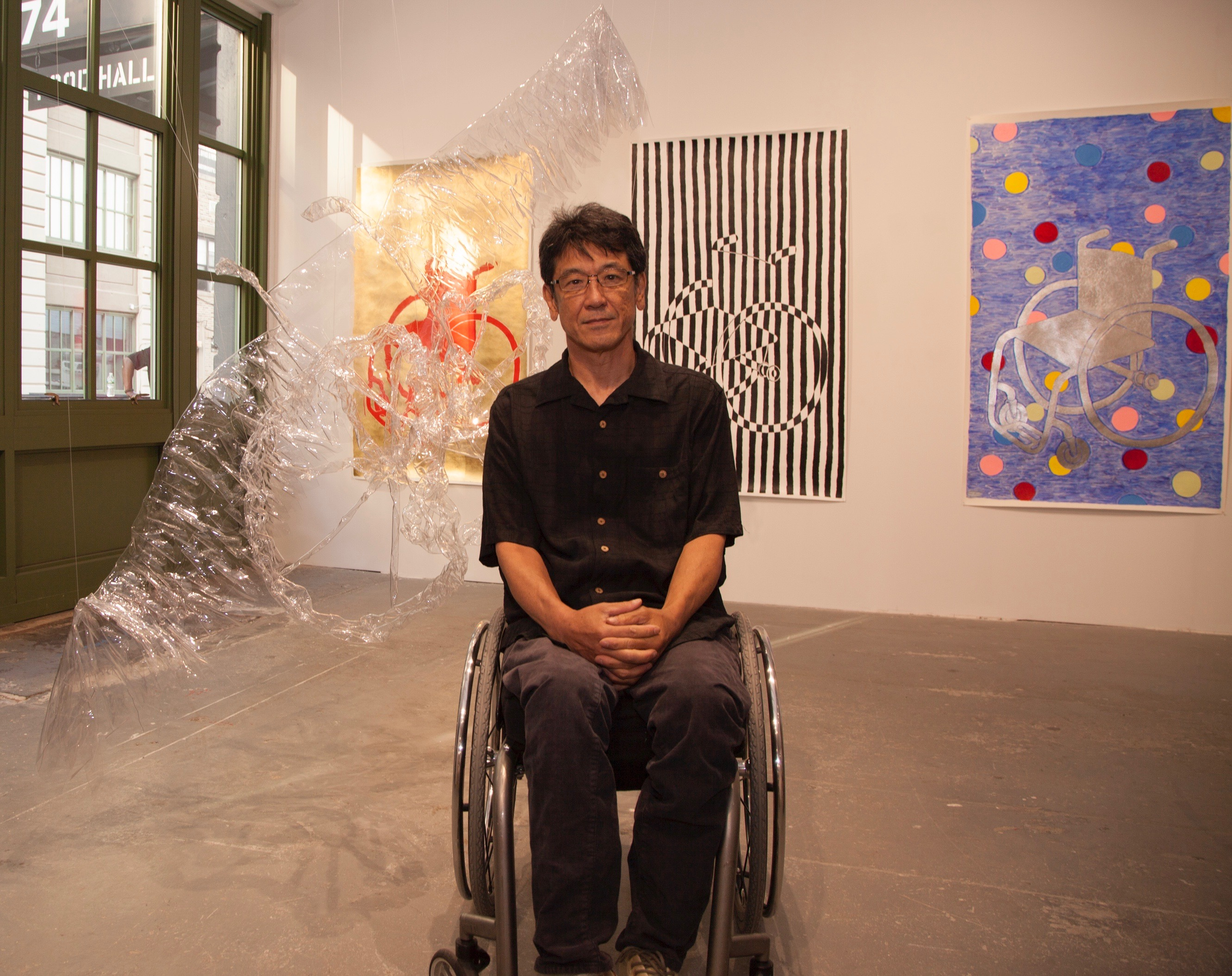 man in wheelchair in an art gallery.