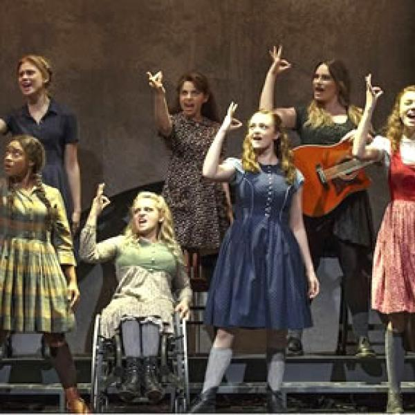 seven women signing a scene in the play Spring Awakening