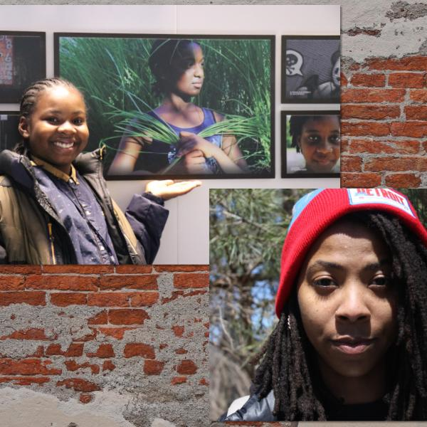 Young African-American youth standing next to his artwork; young African-American girl in red hat.