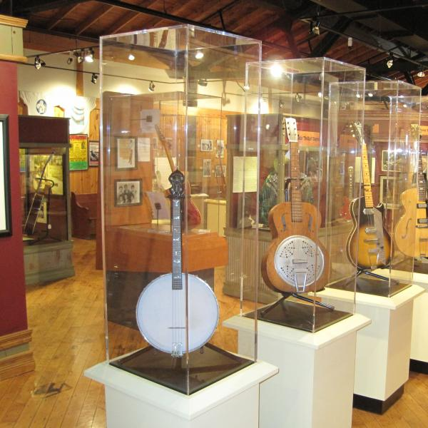 Instruments in glass cases inside a museum gallery.