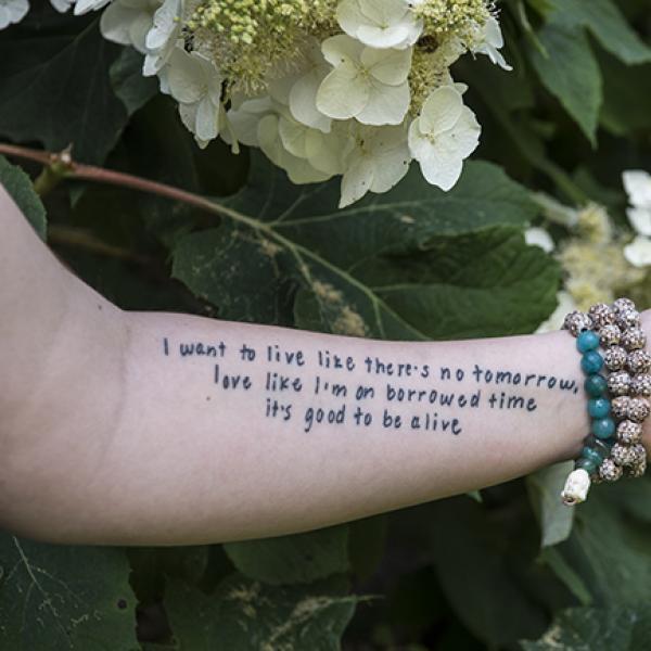 A tattooed arm belonging to a suicide survivor