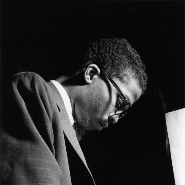 African-American man wearing glasses at the piano.