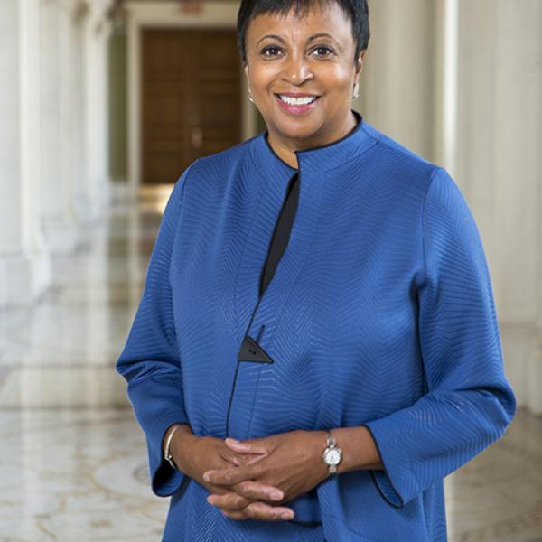 Portrait of Carla Hayden in a hall in the Library of Congress.