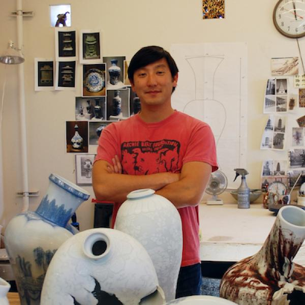 artist Steven Young Lee in his studio with several of his quote unquote broken vases