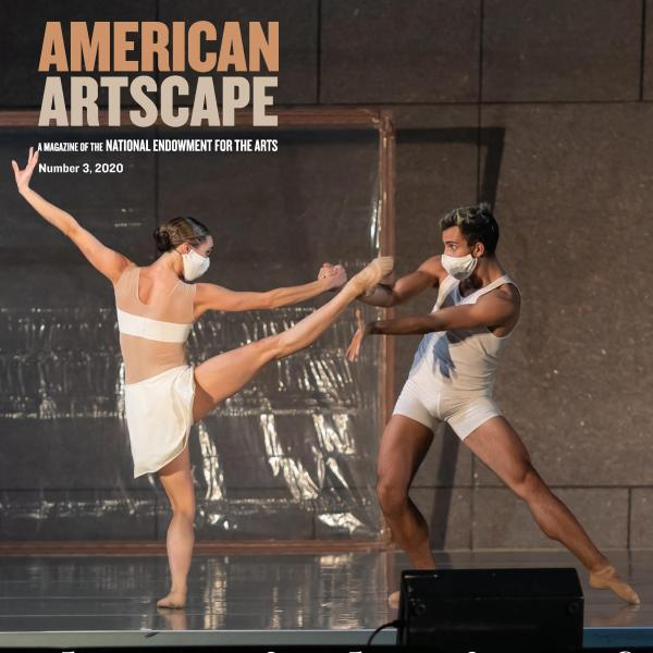 Two ballet dancers in a pas de deux wear masks as they perform onstage