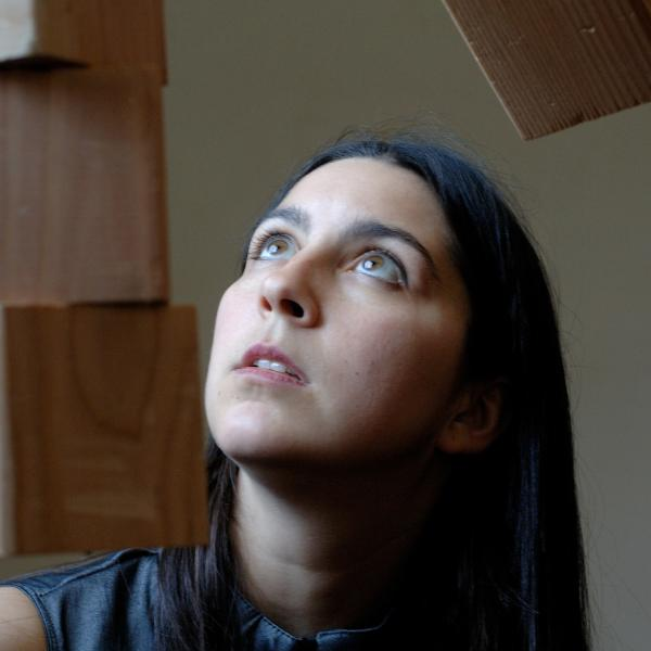 Woman looking up as blocks drop around her.