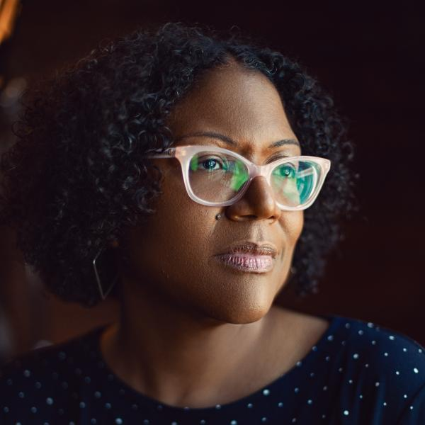 Author photo of Honorée Fanonne Jeffers, who is wearing pink glasses and a polka dot top.