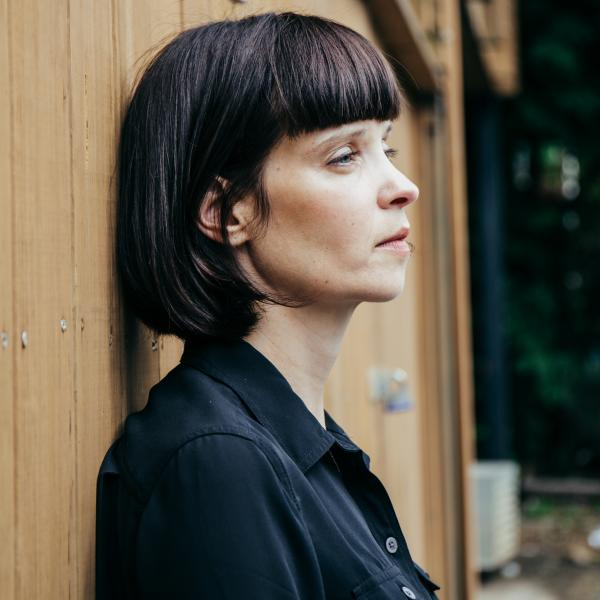 Profile shot of woman with short brown bob haircut