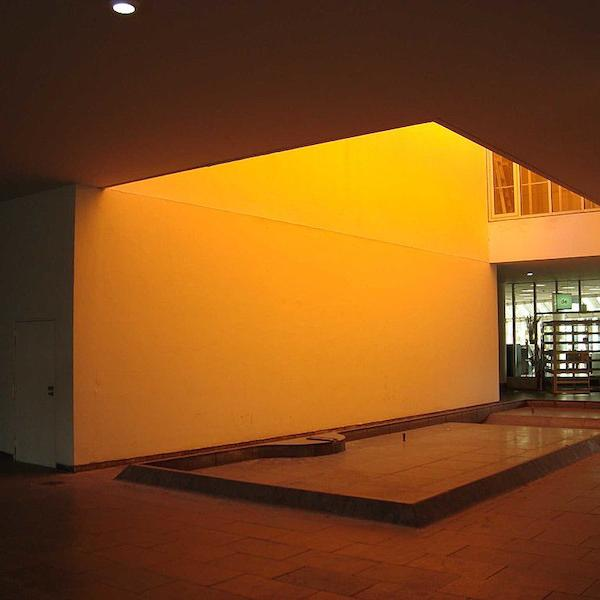 a room bathed in yellow light from an unseen light source from above