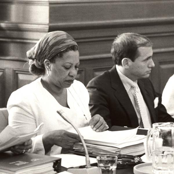 Author Toni Morrison with notebook and microphone serving as a panelist