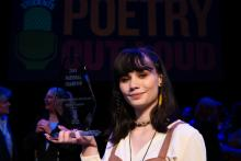 Isabella Callery holds her Poetry Out Loud National Champion glass trophy