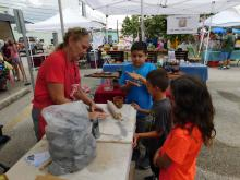 children at art fair play with clay
