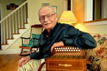 Joe Derrane at home with his accordion