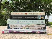 a stack of new Big Read books in a garden setting
