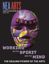Cover of NEA Arts magazine with a mask on it with the word strong and other embellishment