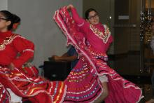 Young Hispanic girl dancing in traditional attire.