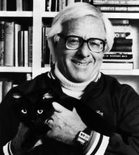 author Ray Bradbury posing with a cat