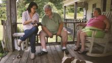 Filmmaker Jennifer Crandall on a porch with two older white people