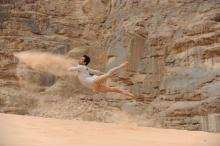 dancer leaping in the air in the desert