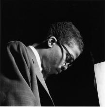 Close-up of jazz musician Herbie Hancock playing a piano