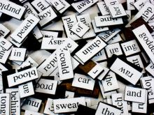 a pile of magnetic poetry fridge tiles