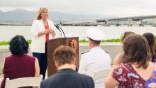Mary Anne Carter delivers remarks against backdrop of Pearl Harbor