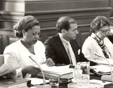 Toni Morrison reading applications at a meeting.