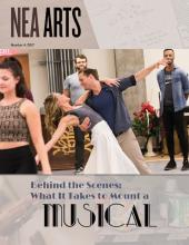 cover of 2017 Vol 4 issue of NEA Arts with center photo of couple rehearsing a dance move and text that says Behind the Scenes What It Takes to Mount a Musical