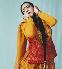 South Asian dancer in traditional dance pose.