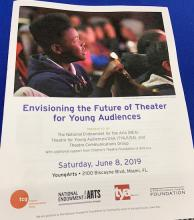 cover of paper program for convening with text and photo of a young man watching a performance