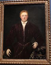 oil painting by Tintoretto of a woman wearing rich looking dark red garments