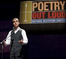 A young man stands behind a microphone mid-performance. A banner saying Poetry Out Loud is visible above his head