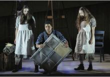 Three characters from Missy Mazzoli's Proving up, including one man who is kneeling flanked by two young women.