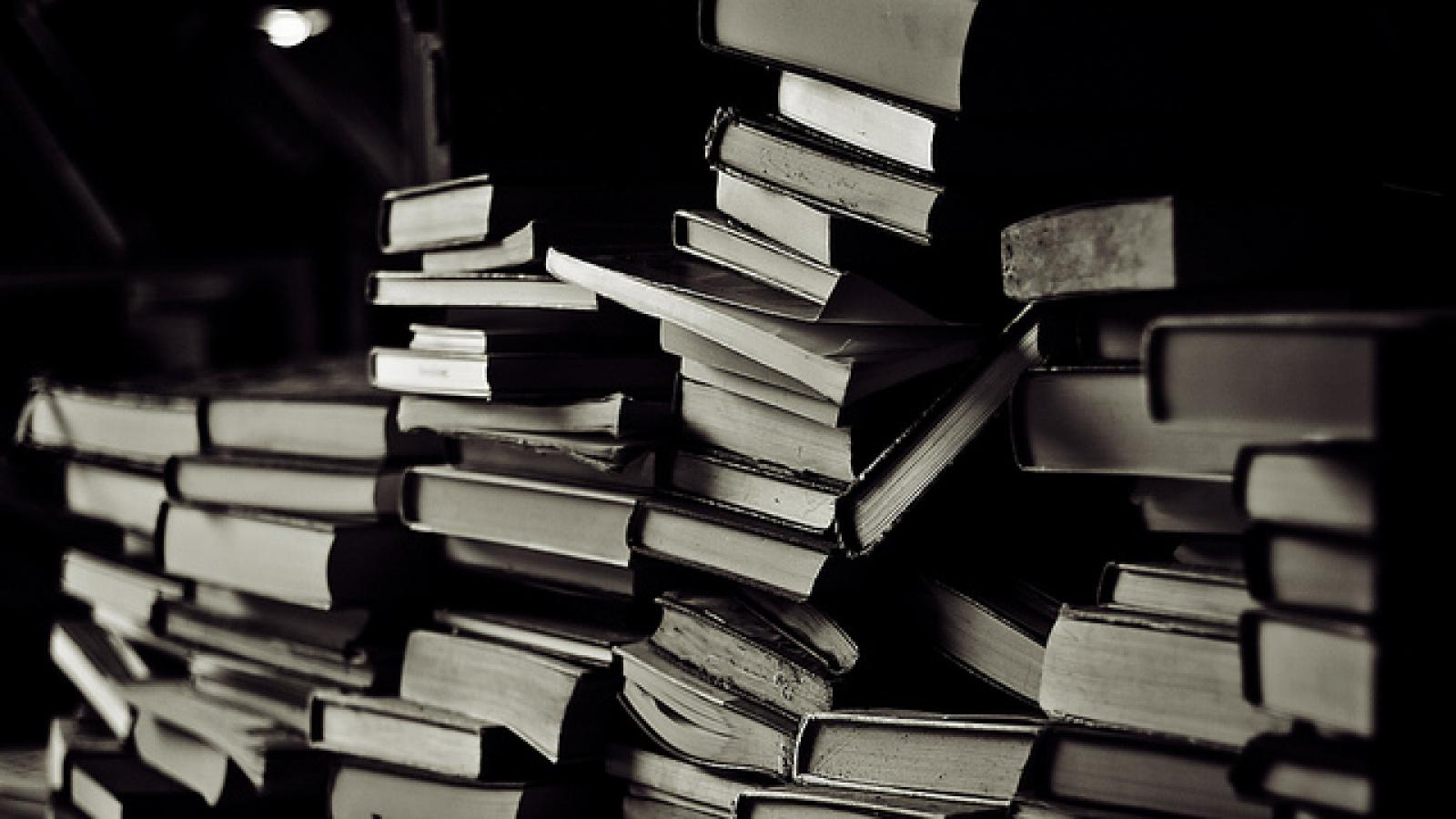 Black and white photo of stack of books