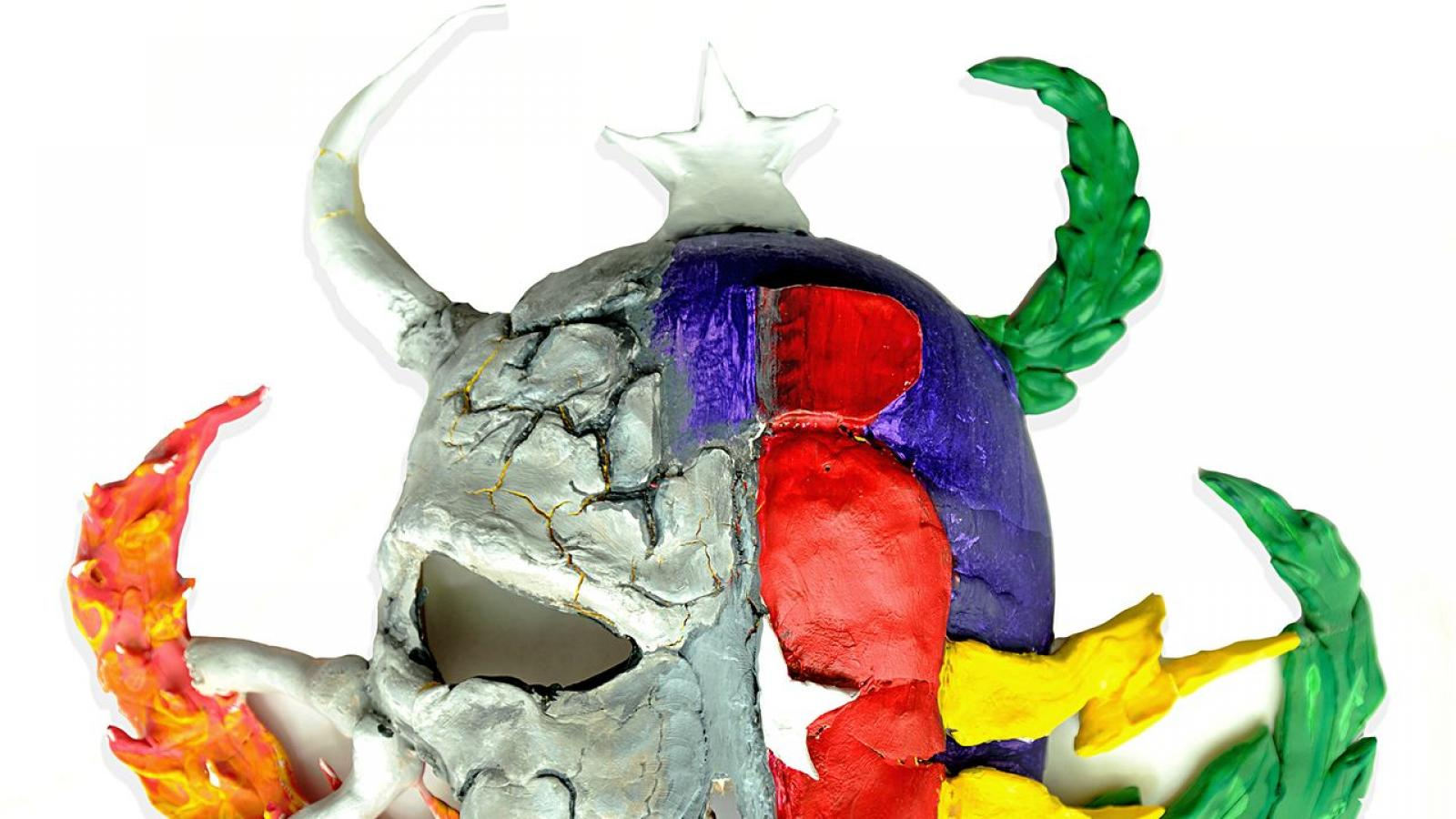 mask with half a skull and flame and half with laurels and lightning