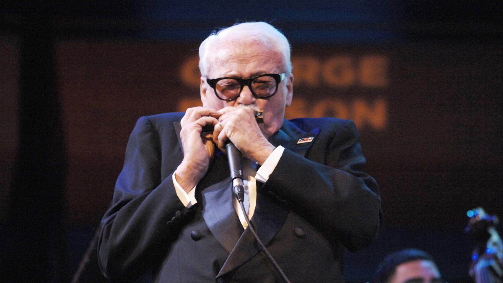 Toots Thielemans performs on the harmonica